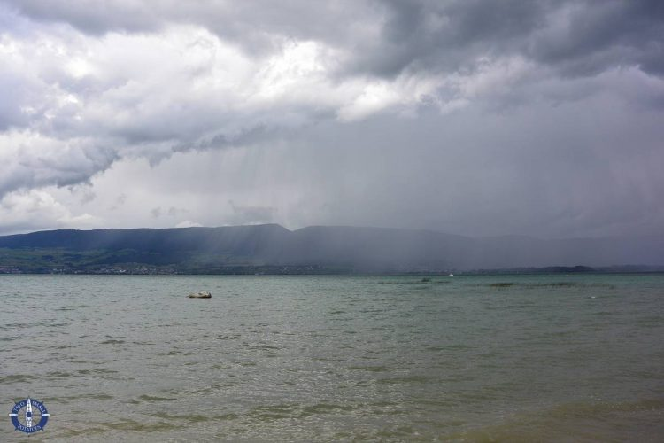 Rain clouds roll across Lake Neuchatel during an autumn storm in Switzerland
