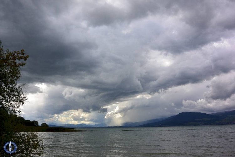 Black clouds roll over Lake Neuchatel during a storm in Switzerland