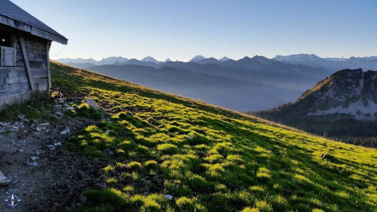 Alpine chalet at sunrise while hiking Schafberg Peak in Switzerland