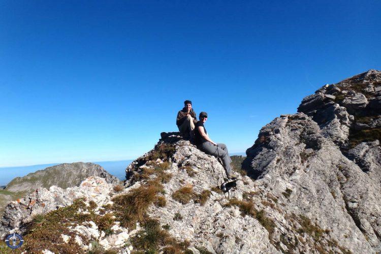 Resting along Schafberg Ridge on a hike to the peak