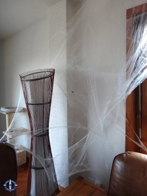 Expat lifestyle in Switzerland, lamp decorated with cob webs for Halloween