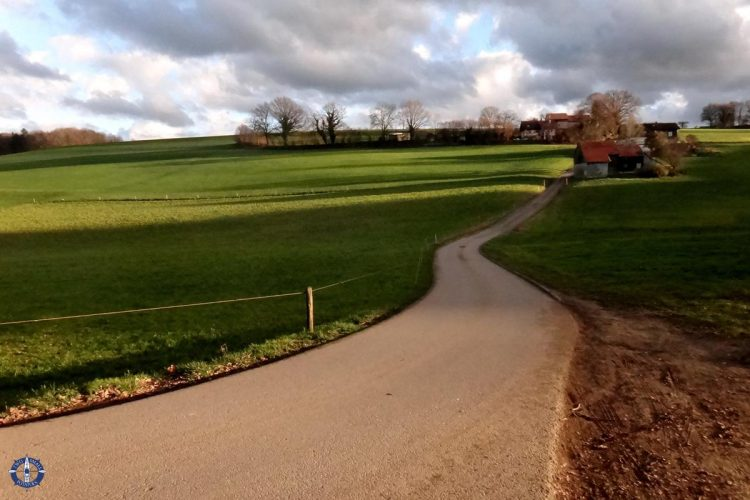 Pretty country farm road in La Brillaz, Switzerland