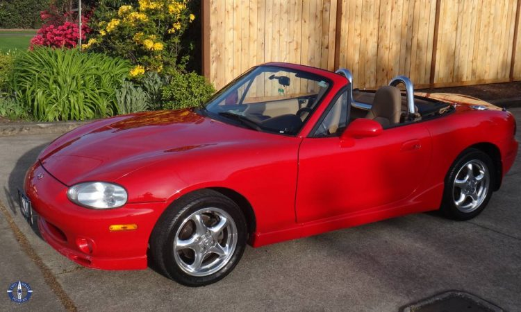 Carrie's sweet cherry red Mazda MX5 convertible in Springfield, Oregon