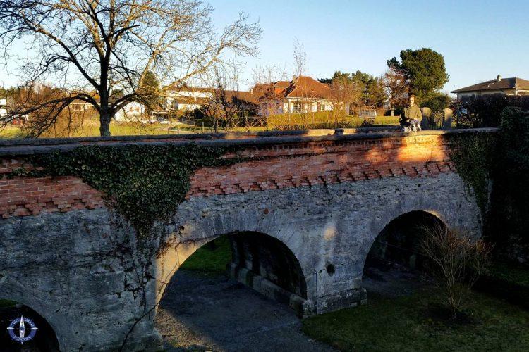 Arched stone bridge leading to the Chenaux Castle in Estavayer le Lac, Switzerland