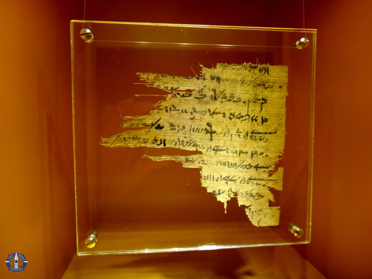 Ancient writing on papyrus at a museum in Basel, Switzerland
