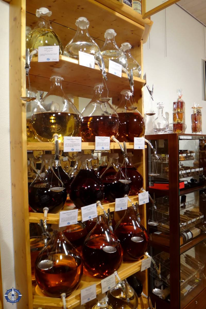 Glass casks for liqueur on tap at Vom Foss