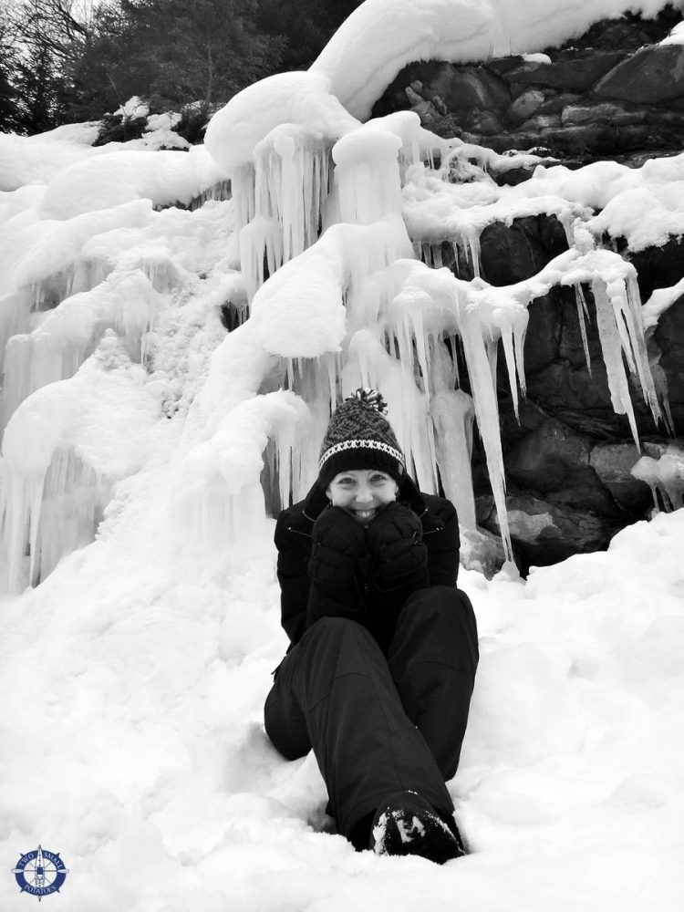 Carrie at a frozen waterfall at Moleson-sur-Gruyeres