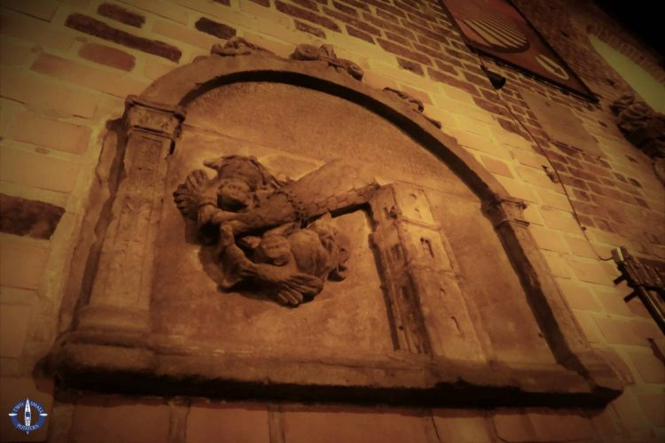 Stone relief on facade of St Elizabeth Church in Wroclaw