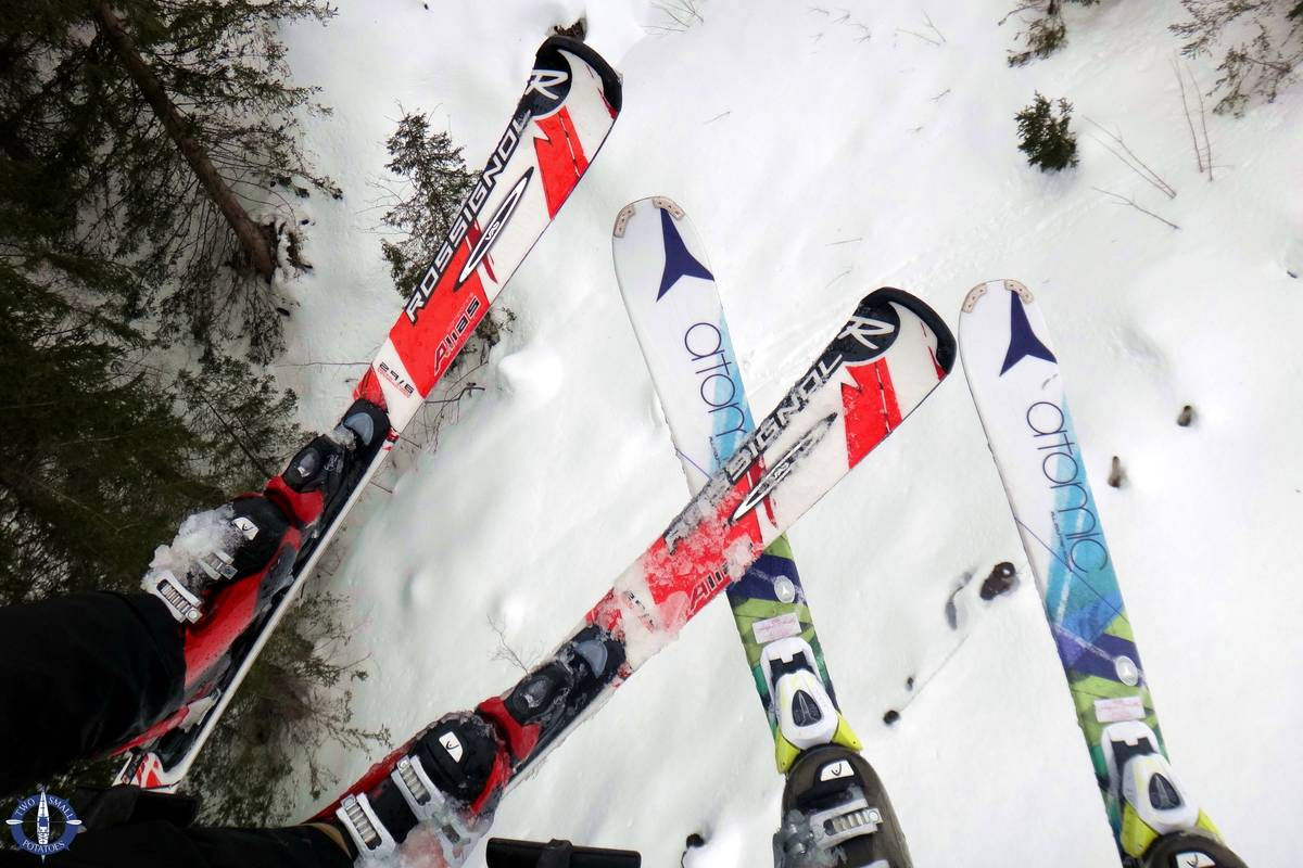 Skis dangling from lift in Charmey, Switzerland