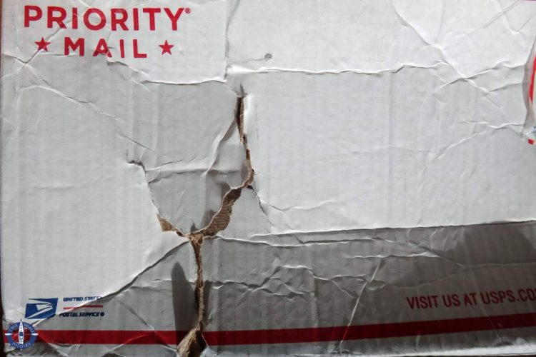 Damaged care package box shipped from USA to Switzerland
