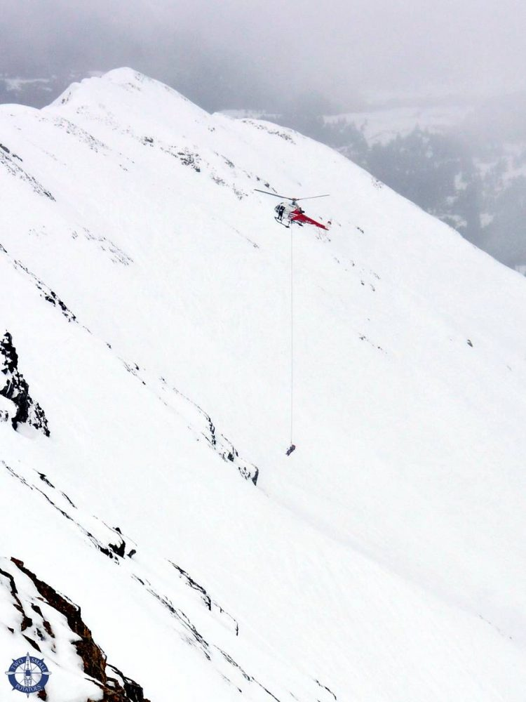 Helicopter rescuing a skier in distress in Les Diablerets, Switzerland