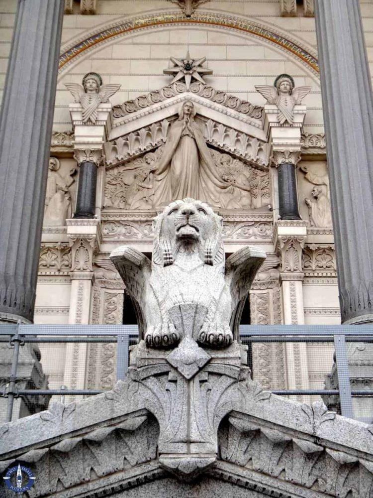 Winged lion at entrance of cathedral in Lyon, France