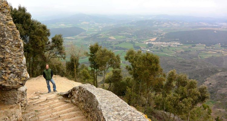 Climbing the stairs to the ruins of Monjardin Castle in Spain at night