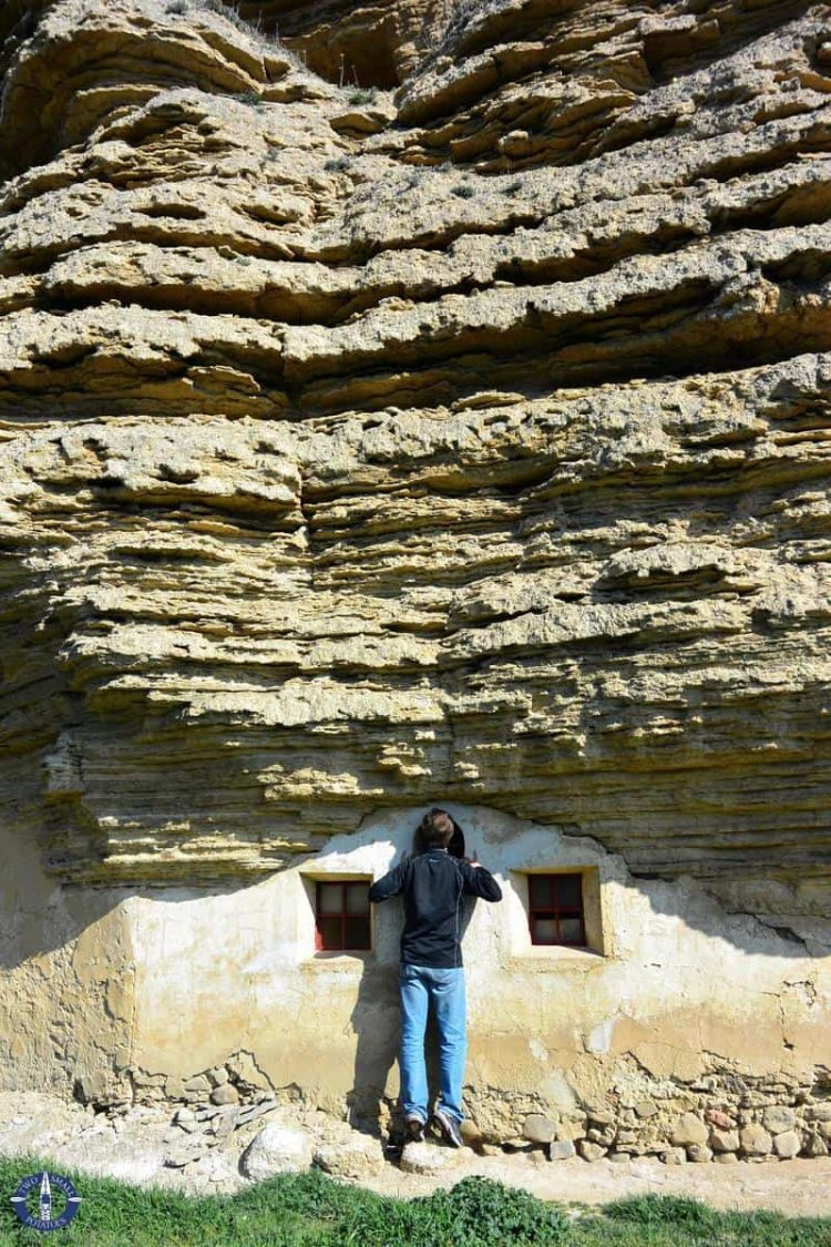 Peaking in windows of a cave hermitage in Spain