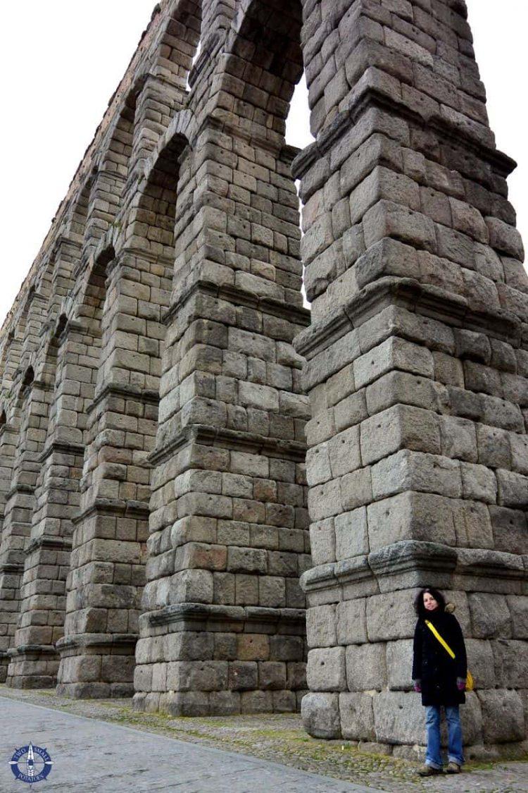 Beneath the towering Roman Aqueduct of Segovia, Spain