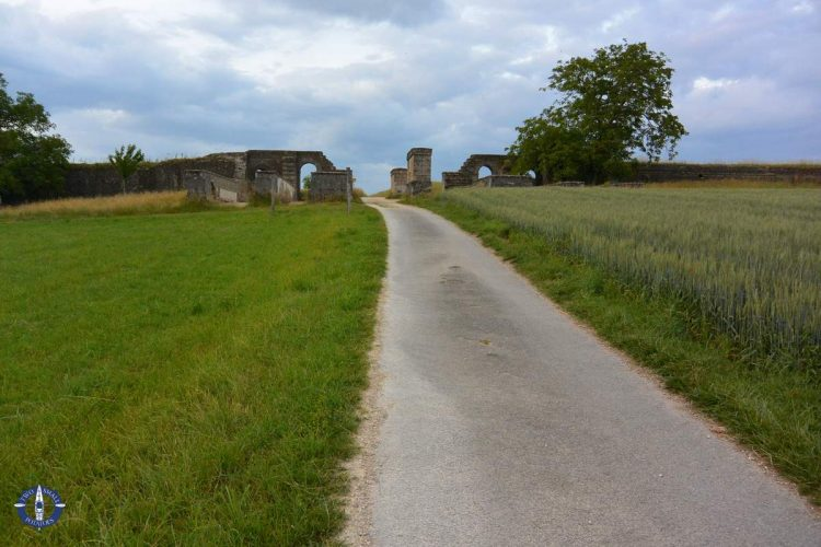 Country road through the East Gate of fortress walls around Avenches