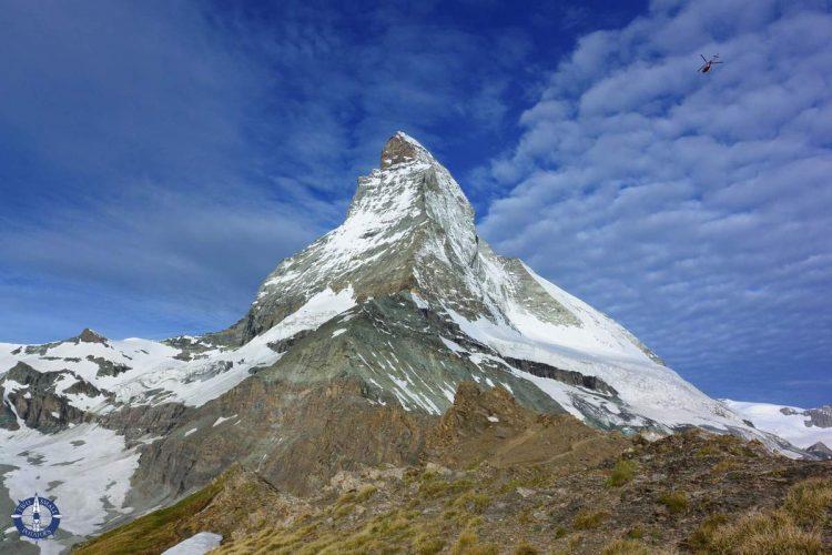 Chopper delivering supplies to an alpine hut on the Matterhorn