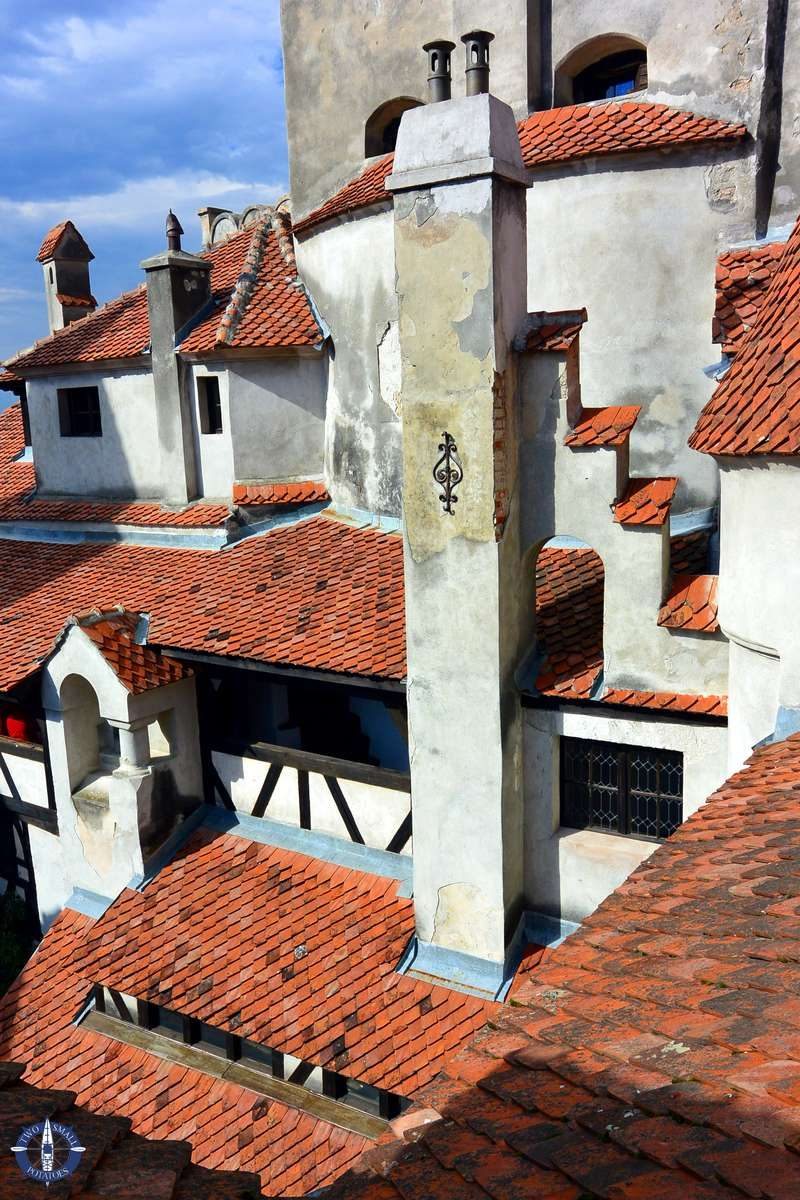 Image of red tile roofs of Bran Castle for sale on Fine Art America
