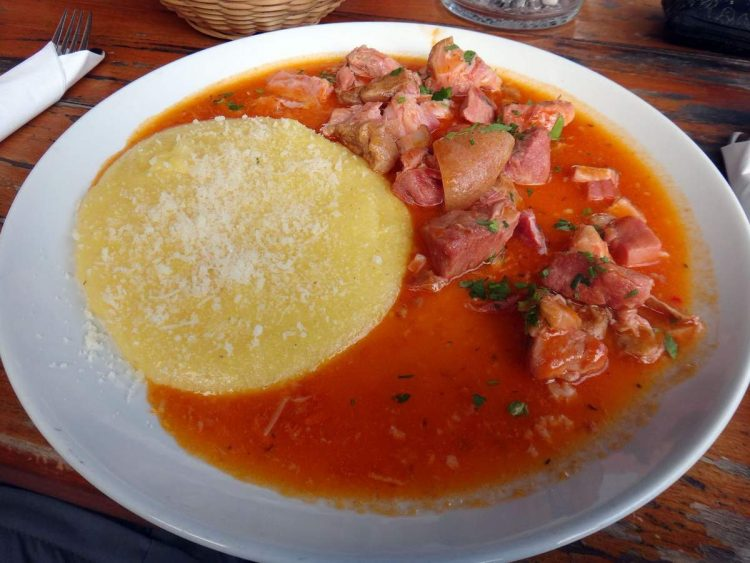 Pork knuckle and polenta in Bran, Romania