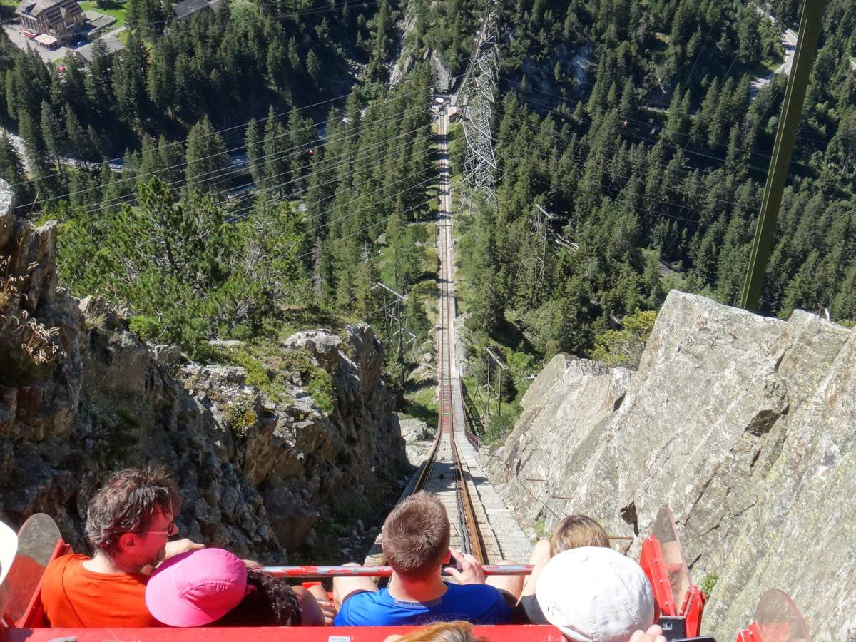 Riders look straight down the tracks on the Gelmerbahn funicular, Switzerland