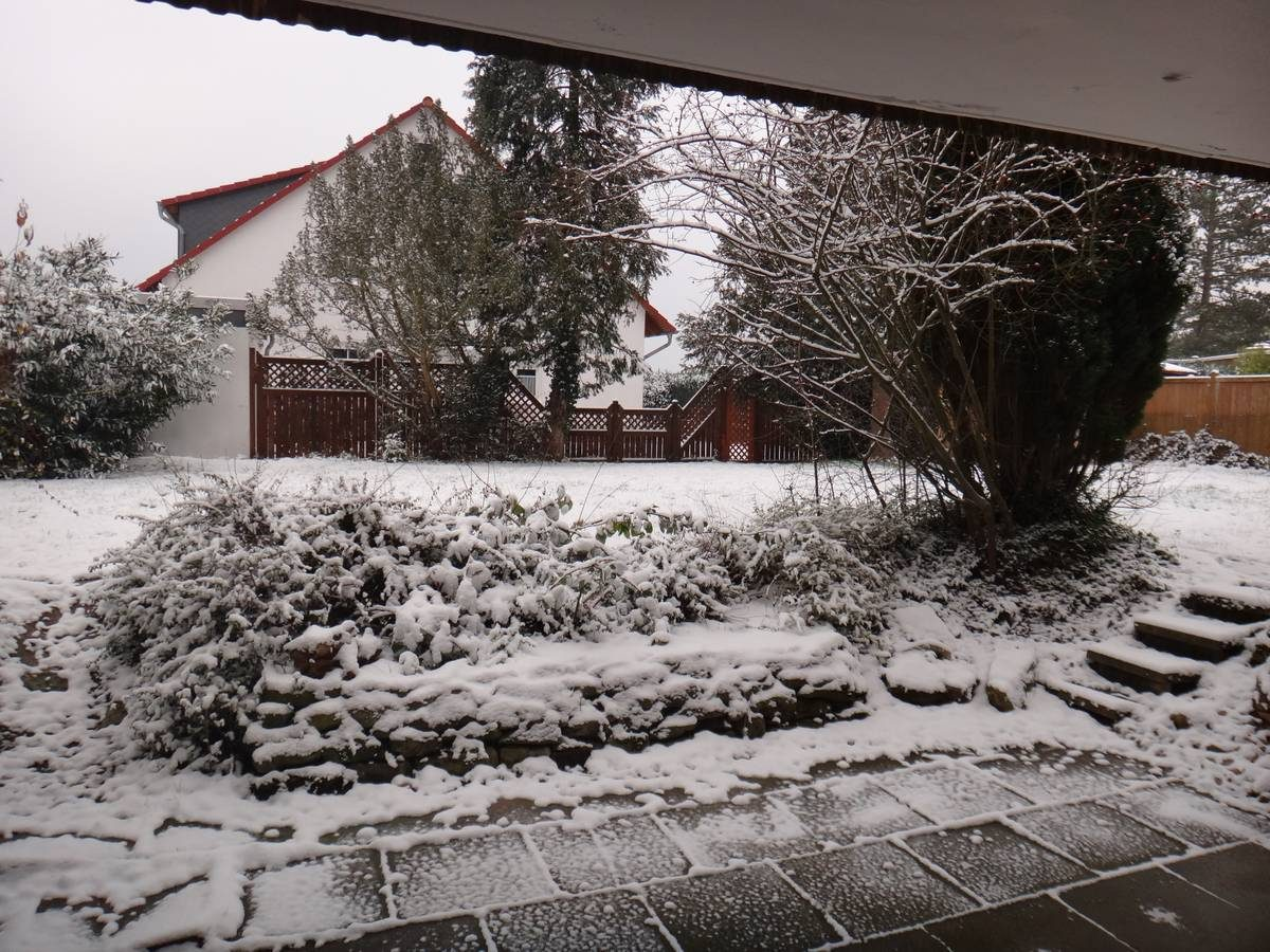 It snows during our first day in our new apartment in Germany