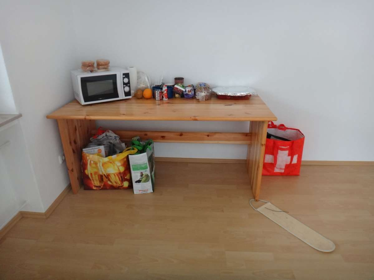 Our only furniture during our first day in our new apartment in Germany