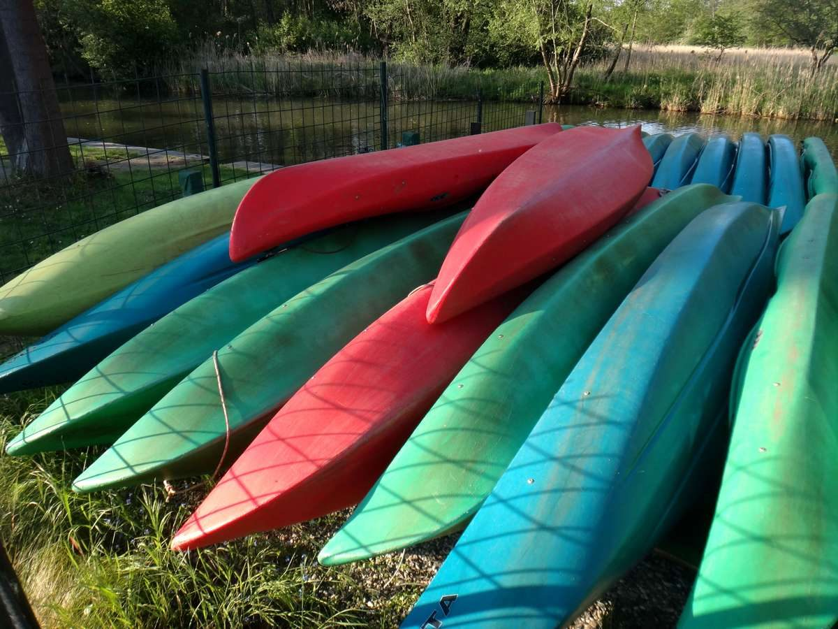 Colorful kayaks for rent at Spreewald Natur Camping, Germany