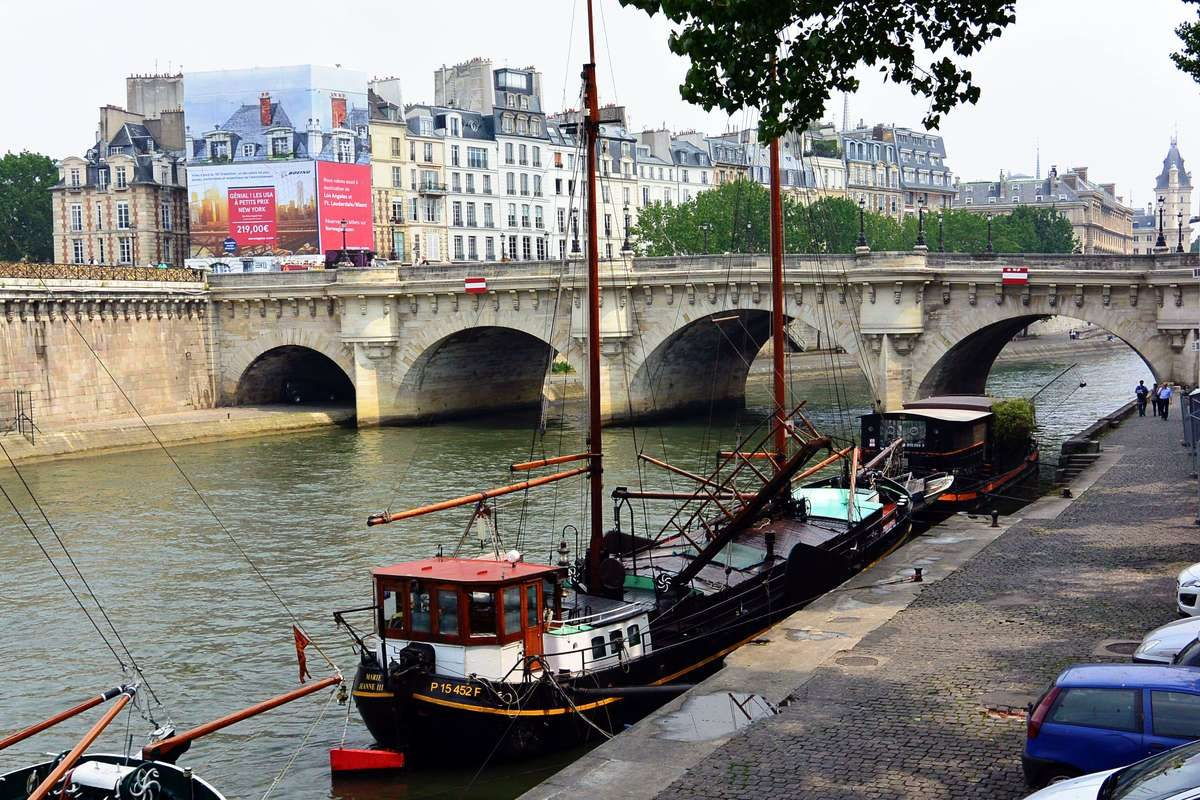 Boats moored along the Seine River in Paris