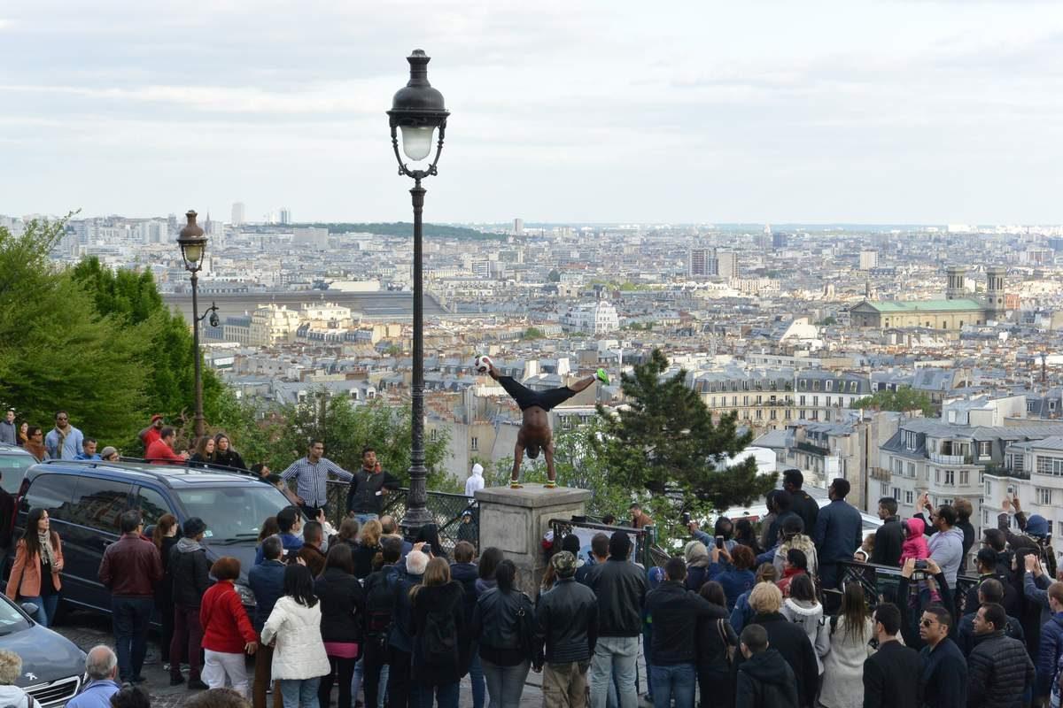 Break dancer at Sacre-Coeur, Paris