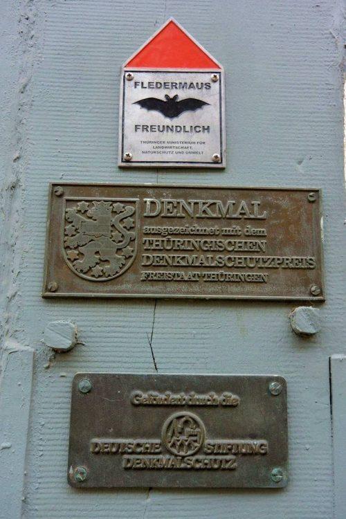 Denkmal sign for Fledermaus, Creuzberg, Germany