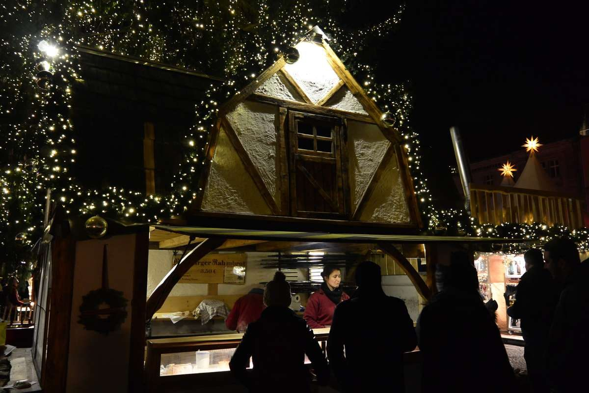 Festive food booth at the Gendarmenmarkt Christmas Market in Berlin