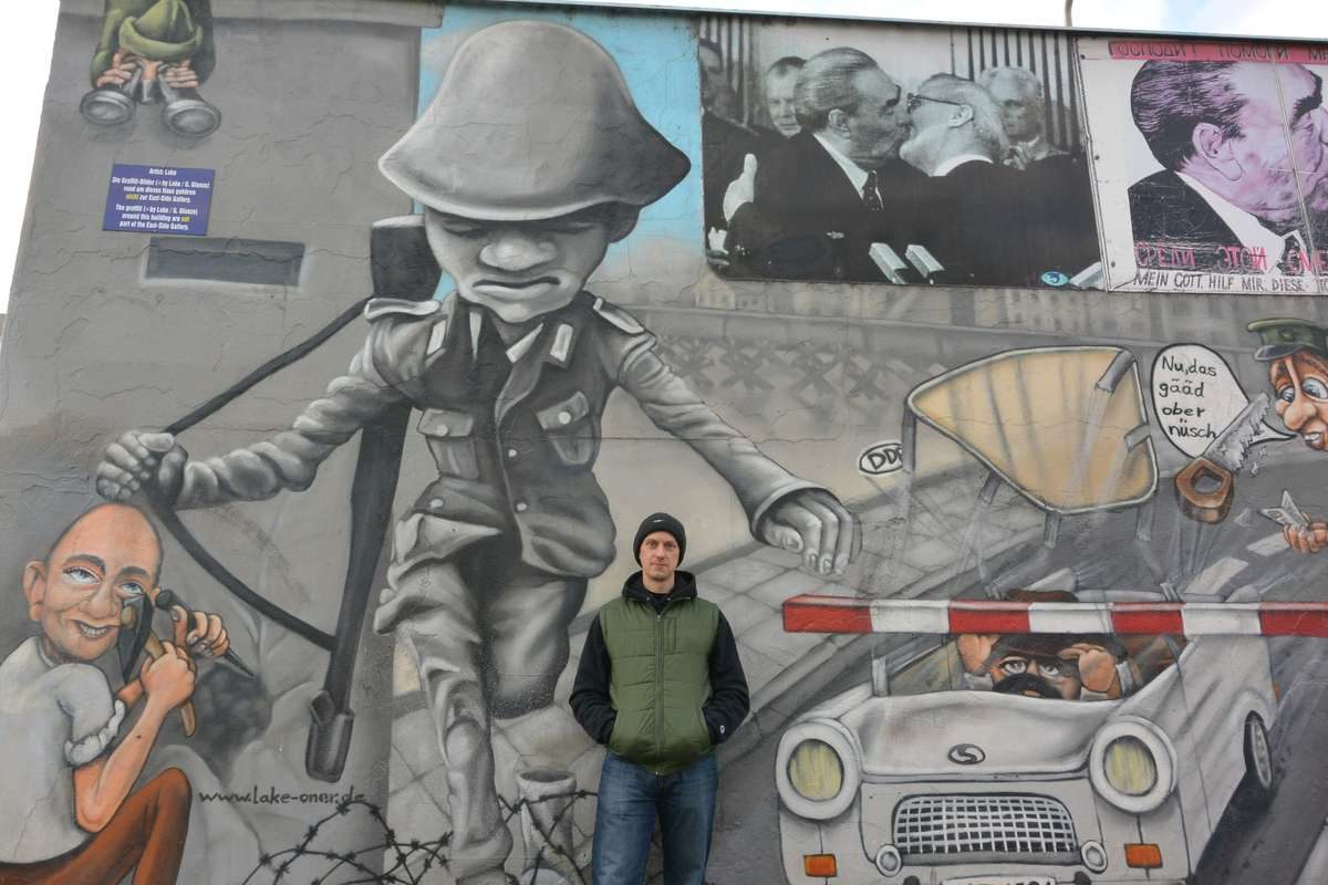 East Side Gallery mural of Checkpoint Charlie in Berlin