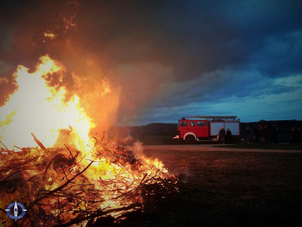 A fireman waits near an Easter bonfire in Germany