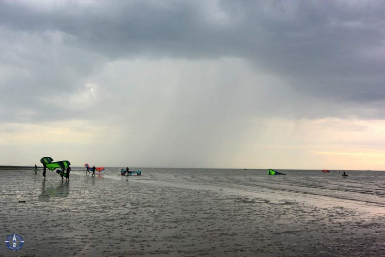 Kiteboarders leave the water before a storm in Cuxhaven, Germany